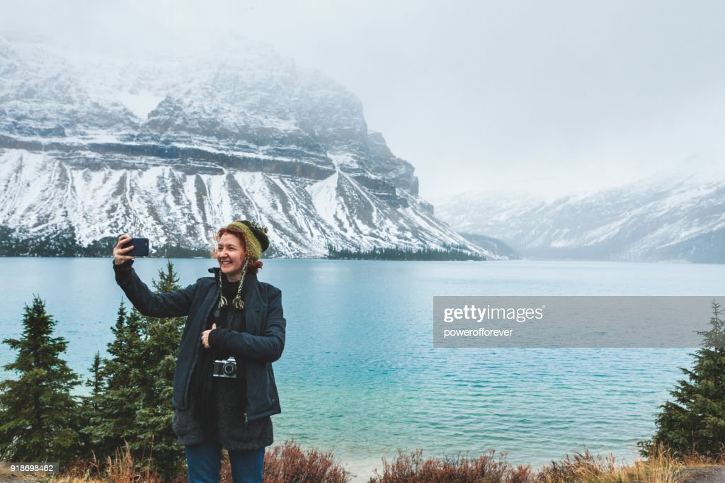 Tourist taking a Selfie in the Canadian Rocky Mountains : Stock Photo