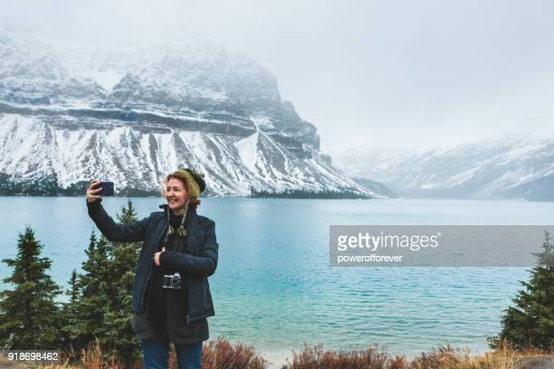 Tourist taking a Selfie in the Canadian Rocky Mountains