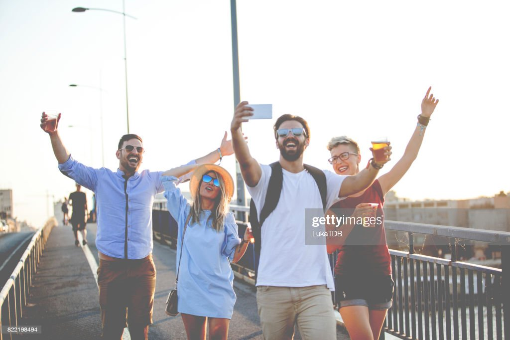 Tourist taking crazy selfie : Stock Photo