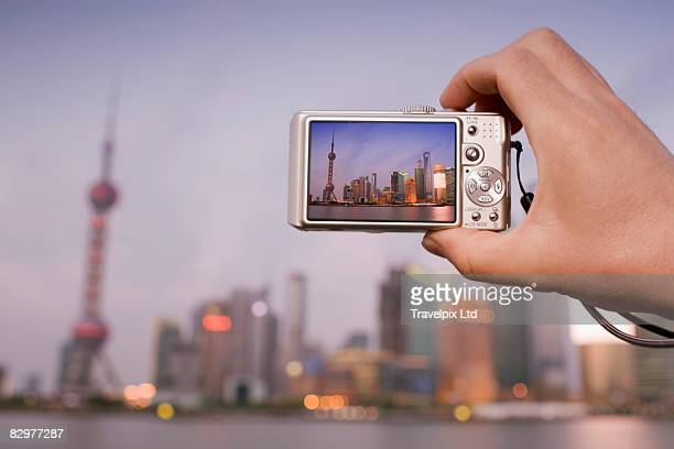 tourist taking digital picture of skyline - digital camera stock pictures, royalty-free photos & images