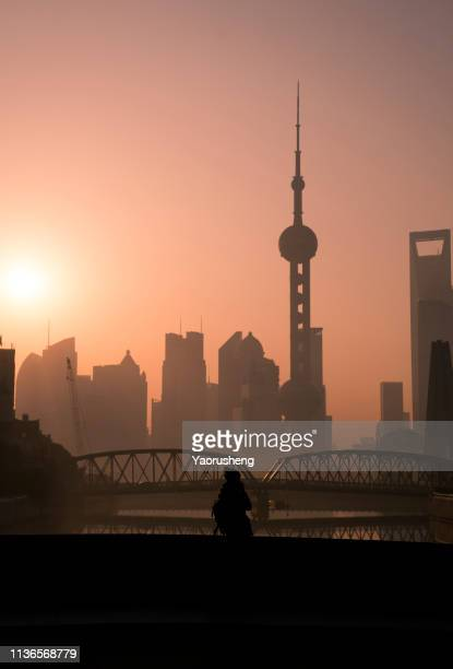Tourist taking photo in Shanghai morning,Shanghai bund,China