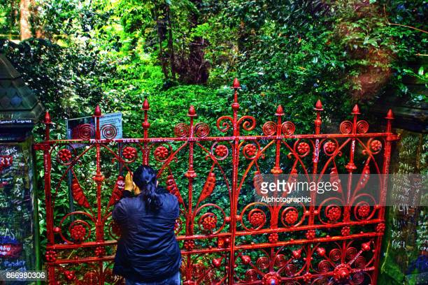 tourist taking photograph of strawberry fields in liverpool - merseyside stock pictures, royalty-free photos & images