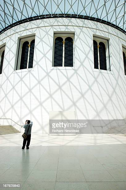 CONTENT] Tourist taking photos in The Grand Court at The British Museum London 30th April 2012