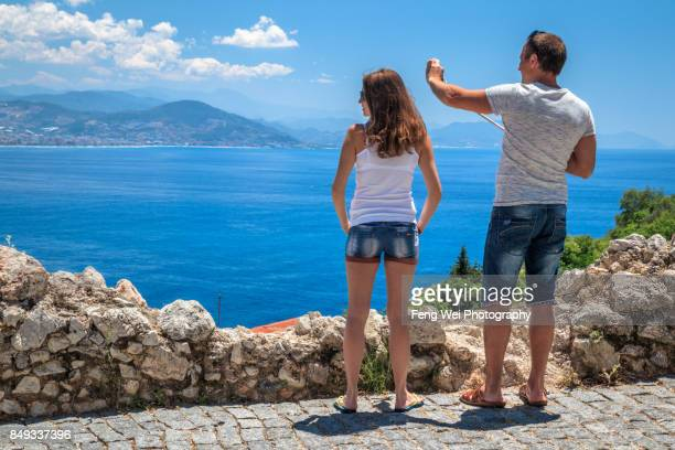 Alanya, Antalya, Turkey - May 21, 2017: tourist taking photos on the way to Alanya castle