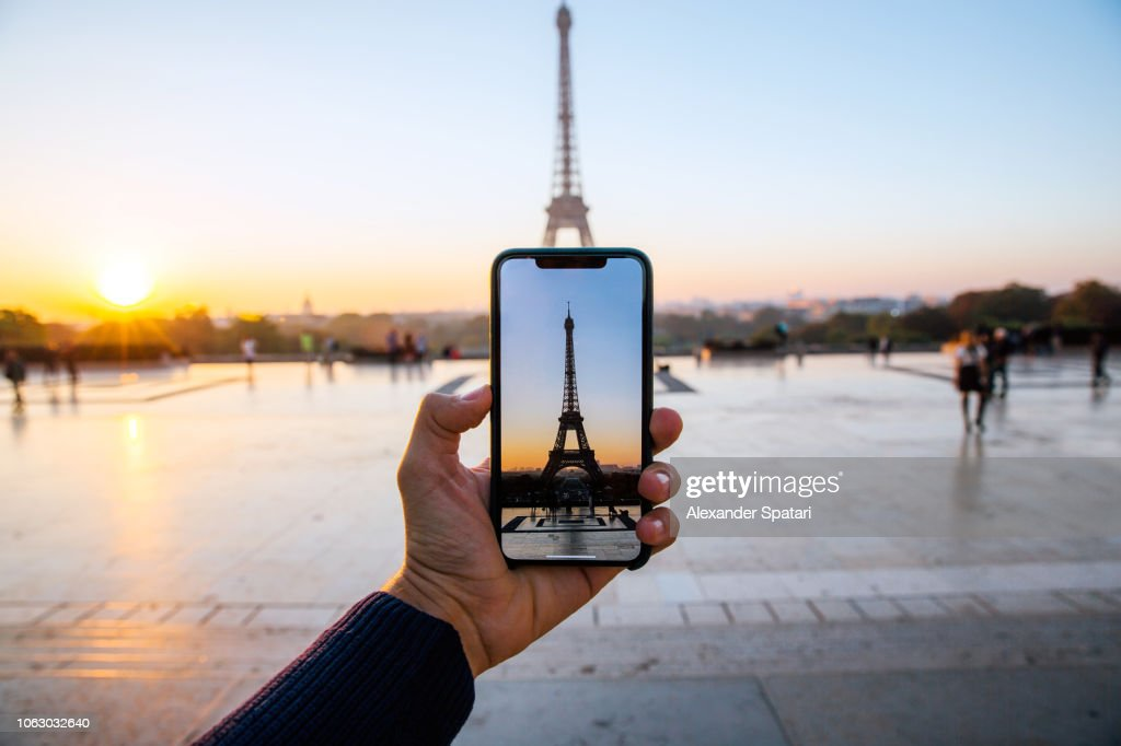 Tourist taking picture of Eiffel Tower with smart phone, personal perspective view, Paris, France : Stock Photo