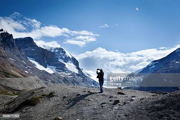 Tourist Taking Picture of Glacier in Jasper National Park Canada