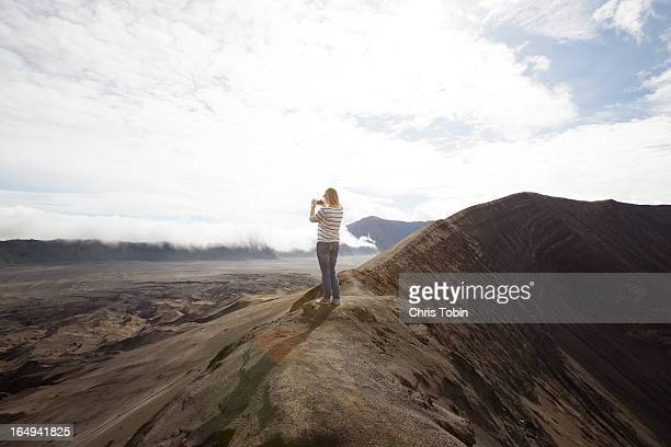 Tourist taking picture on a desert mountain