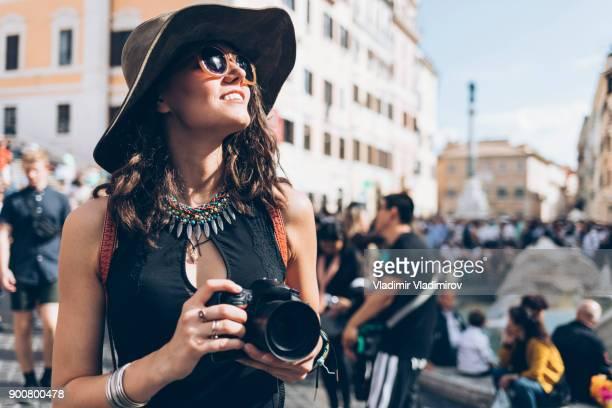 Tourist taking pictures in front of Trinità dei Monti church