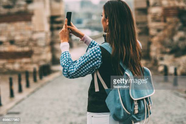 tourist taking pictures - radio wave stock pictures, royalty-free photos & images