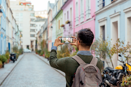 Tourist taking pictures with mobile phone on the street, rear view, Paris, France - gettyimageskorea