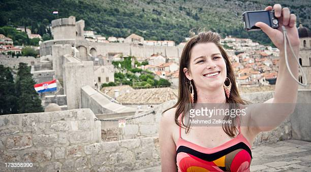 tourist taking self portrait in dubrovnik - spaghetti straps stock photos and pictures