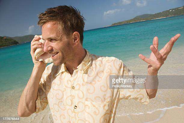Tourist Talks on his Shell Phone Tropical Bay