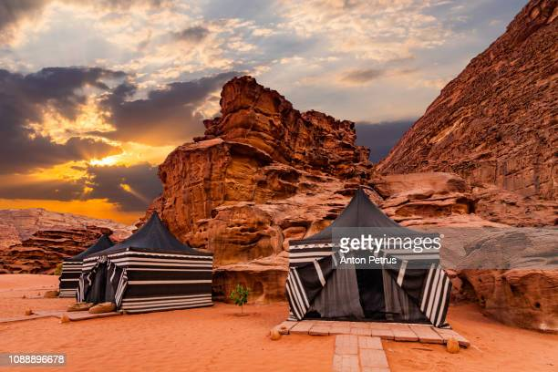 tourist tents in wadi rum desert at sunset. jordan. - ヨルダン ストックフォトと画像