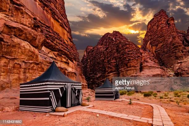 tourist tents in wadi rum desert at sunset. jordan. - bedouin stock pictures, royalty-free photos & images