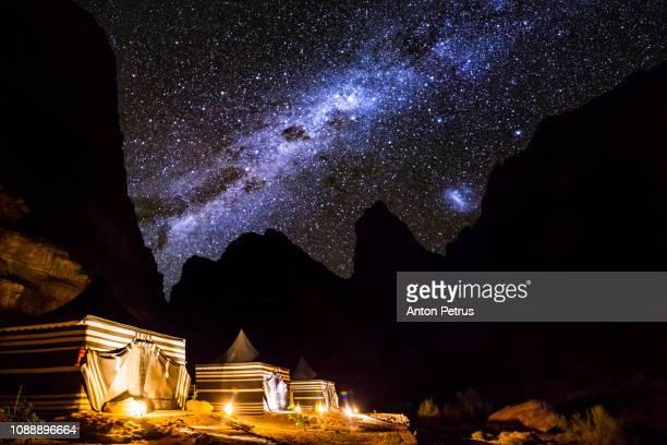 tourist tents in wadi rum dessert at night. jordan. - bedouin stock pictures, royalty-free photos & images
