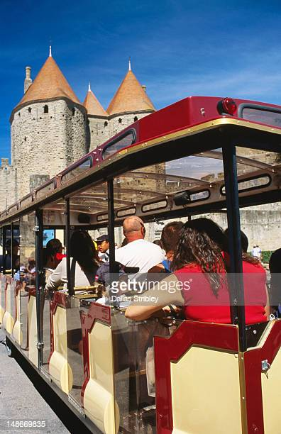 tourist train, porte narbonnaise. - guy carcassonne stock pictures, royalty-free photos & images