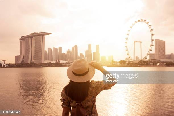 tourist travel in singapore. - singapore stock pictures, royalty-free photos & images