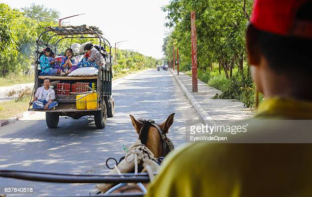 Tourist travel on a horsecart in the historical zone Bagan with thousands of pagodas and temples on December 10 2016 in Bagan Nyaung U Myanmar