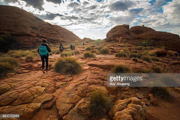 Tourist trekking in Kings Canyon of Centre Australia.