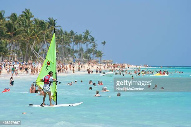 Tourist trying windsurfing