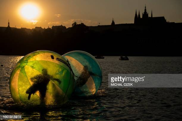 TOPSHOT Tourist use zorb balls on the Vltava river on July 19 2018 in Prague