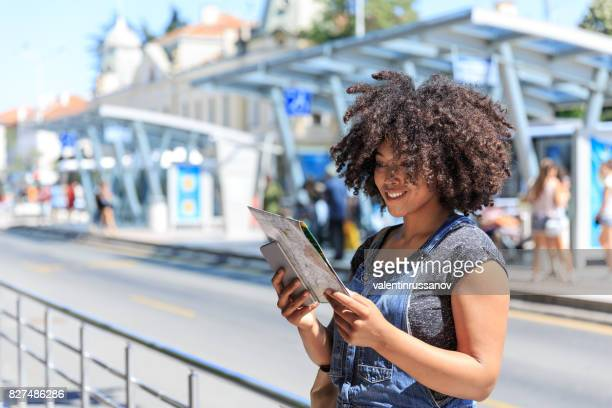 Tourist using a map on bus station