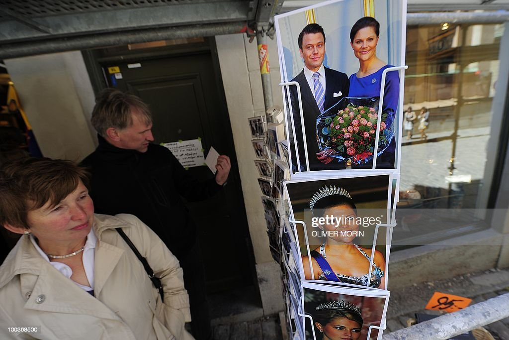 Tourist view postcards featuring Swedish Crown Princess Victoria and her fiance Daniel Westling on a rack, in a souvenir shop near the Royal Castle in Stockholm on May 24, 2010. Many tourists paid a visit to the Swedish capital less than a month before Crown Princess Victoria 's wedding, the 32-year-old eldest daughter of King Carl XVI Gustaf.