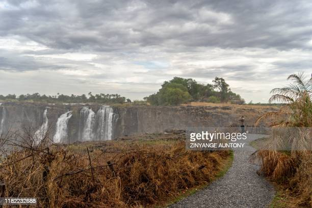 A tourist view the majestic Victoria Falls a tourism attraction for Zimbabwe Victoria Falls on November 13 2019 A series of heat waves has dried most...