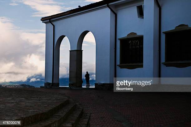 A tourist views the city from Cerro de Monserrate in Bogota Colombia on Tuesday June 16 2015 Colombia's fiscal deficit will widen next year to the...