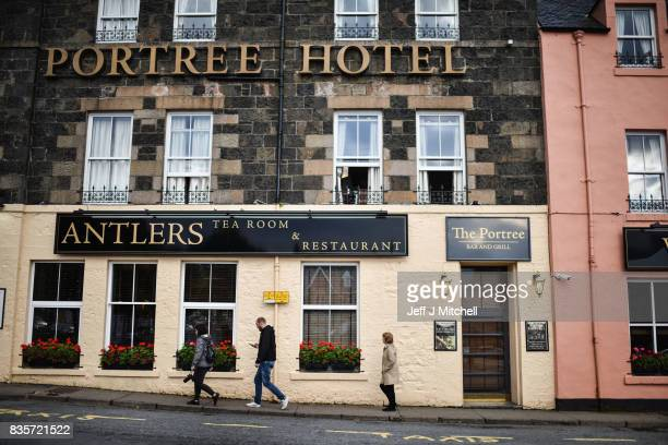 Tourist visit Portree on the Isle of Skye on August 17, 2017 in Portree, Scotland. The Isle of Skye is known as one of the most beautiful places in...