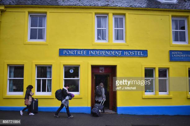 Tourist visit Portree on the Isle of Skye on August 18, 2017 in Portree, Scotland. The Isle of Skye is known as one of the most beautiful places in...