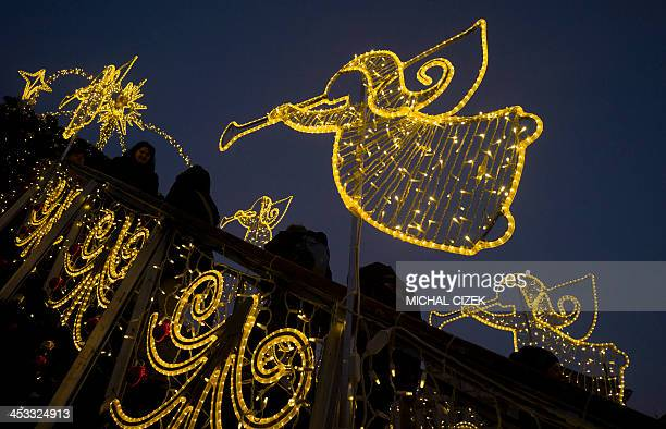 Tourist visit the Christmas market in the Old Town Square in Prague on December 3 2012 AFP PHOTO/MICHAL CIZEK