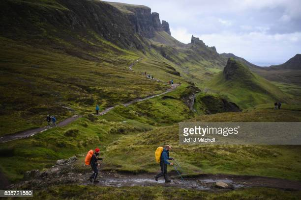 Tourist visit the Quiraing on the Isle of Skye on August 17, 2017 in Staffin, Scotland. The Isle of Skye is known as one of the most beautiful places...