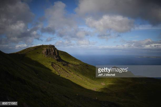 Tourist visit The Storr on the Isle of Skye on August 17 2017 in Portree Scotland The Isle of Skye is known as one of the most beautiful places in...