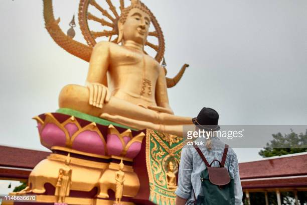 tourist visiting asian temple wat phra yai and big buddha - buddhist goddess stock pictures, royalty-free photos & images