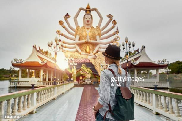 tourist visiting asian temple wat plai laem. statue of the goddess guanyin - buddhist goddess imagens e fotografias de stock