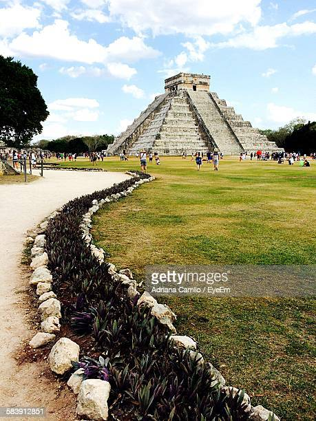 Tourist Visiting Chichen Itza Against Sky