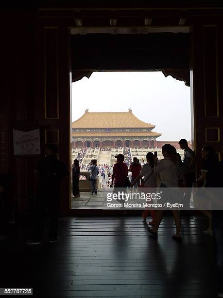 Tourist Visiting Hall Of Supreme Harmony Against Clear Sky