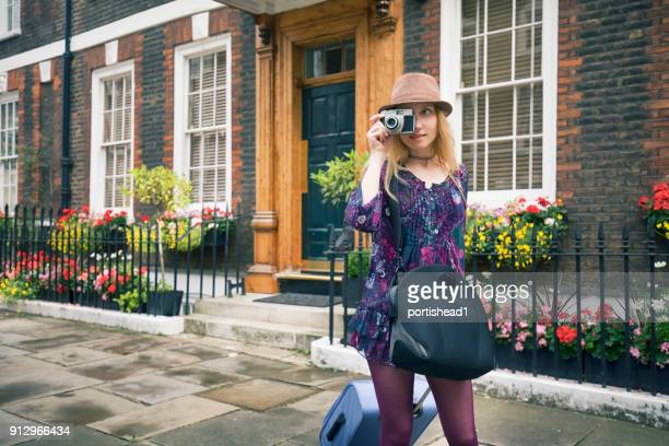 tourist visiting london - photographic film camera stock photos and pictures