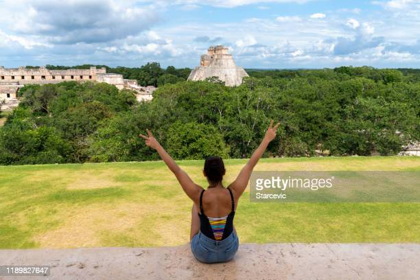 tourist visiting mayan ruins in yucatan, mexico - cancun stock pictures, royalty-free photos & images