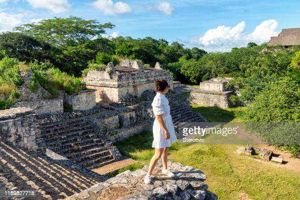tourist visiting mayan ruins in yucatan, mexico - playa del carmen stock pictures, royalty-free photos & images