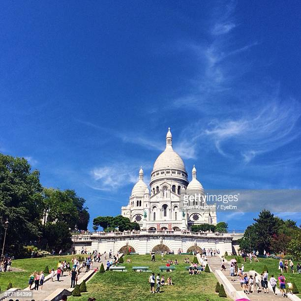 tourist visiting sacre-coeur against sky - basilica stock pictures, royalty-free photos & images