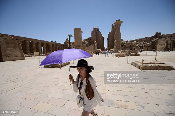 A tourist visits Karnak temple in Luxor a town 700 kilometres south of the Egyptian capital Cairo on June 11 2015 The ancient temple was open as...