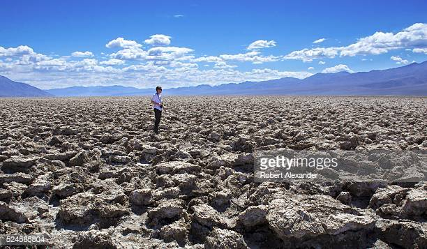 A tourist visits the Devil's Golf Course a popular attraction in Death Valley National Park in California on March 29 2016 The area's large salt...