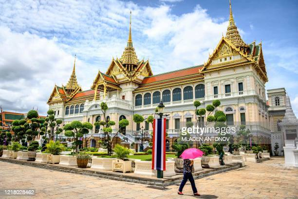 Tourist visits the Grand Palace in Bangkok on June 7 as it reopened for visitors following restrictions to halt the spread of the COVID-19 novel...