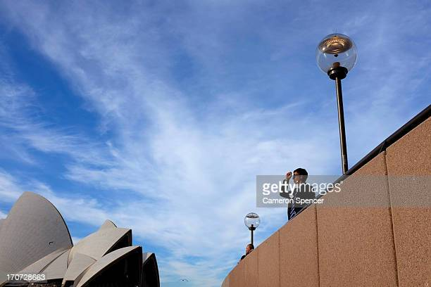 A tourist visits the Sydney Opera House on June 11 2013 in Sydney Australia The New South Wales government is expected to commit AUD $14 million in...