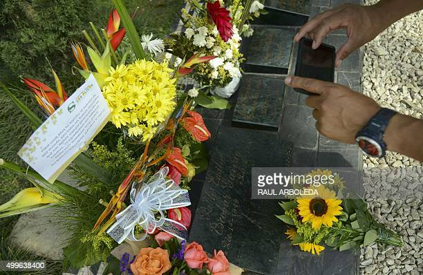 A tourist visits the tomb of Colombian drug lord Pablo Escobar at the Montesacro cemetery in Medellin Antioquia department Colombia on December 2...