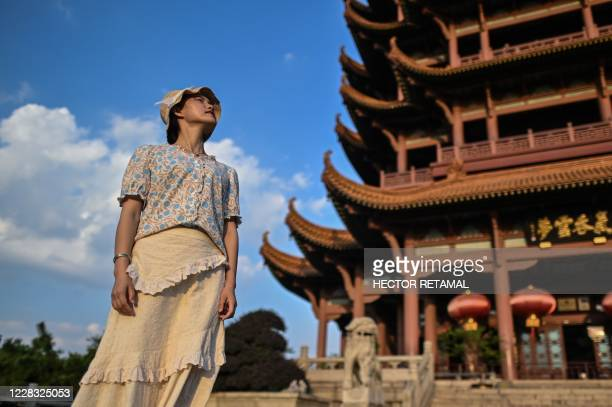 Tourist visits the Yellow Crane Tower in Wuhan, China's central Hubei province photographed on September 3 during a media visit organised by local...