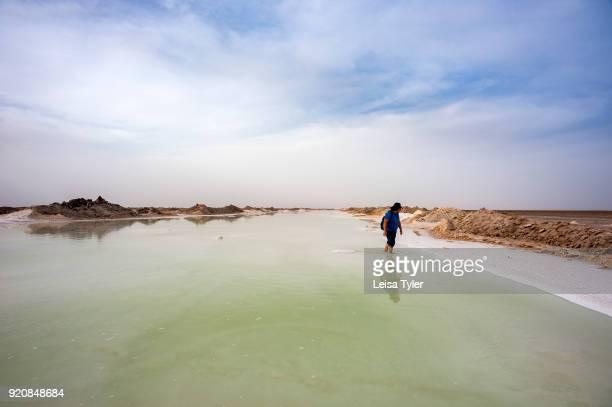 A tourist wading in a salt lake near Varzaneh Iran