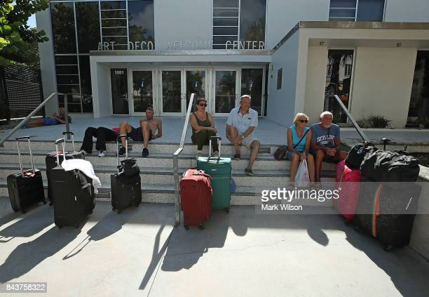 Tourist wait to catch a shuttle to a shelter as the city announced a mandatory evacuation ahead of the approaching Hurricane Irma on September 7 2017...